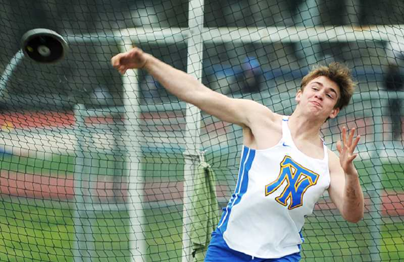 SETH GORDON - Sophomore Jared LaPointe throws the discus March 21 during Newberg's 83-61 home win over Gresham. LaPointe set a new personal-best with a throw of 112 feet, 11 inches to place second.