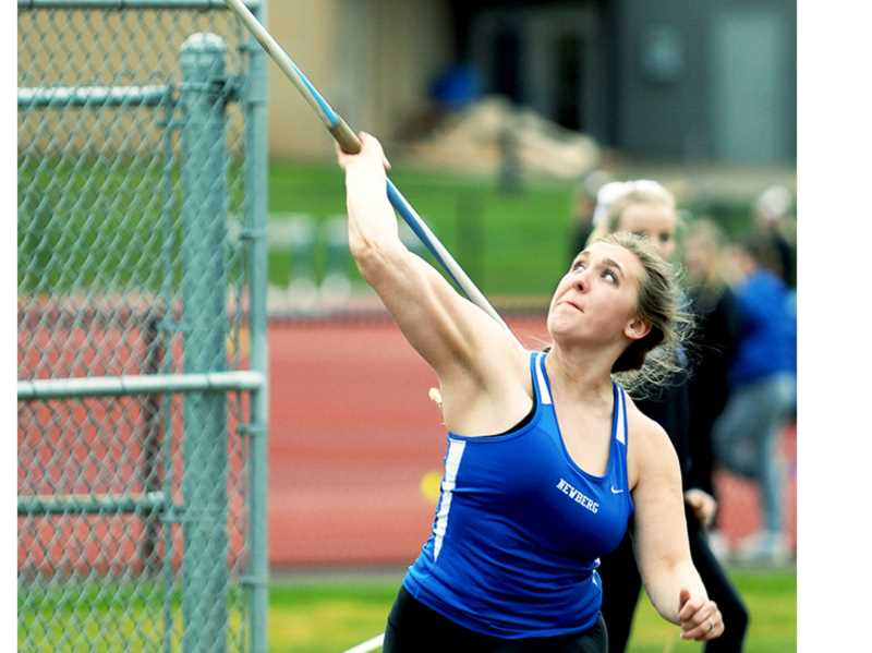 SETH GORDON - Newberg's Noelle Sawyer launches the javelin March 21. The senior finished second with a throw of 114 feet, 7 inches as the Tigers beat Gresham 115-29.