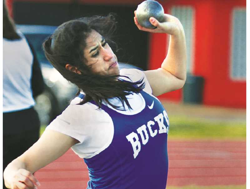 PHIL HAWKINS -- WOODBURN INDEPENDENT - St. Paul sophomore Abby Gonzalez competes in the shot put March 22 at the Mid-Valley Matchup at Molalla High School. Gonzalez placed fourth with a toss of 26 feet, 6 inches.