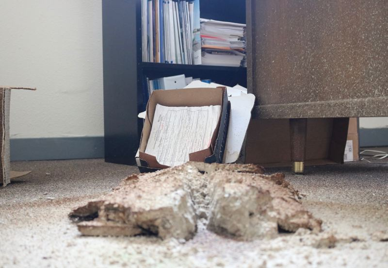 OUTLOOK PHOTO: ZANE SPARLING - Chuncks of the ceiling have fallen onto the carpet of the second floor of the former Troutdale City Hall.