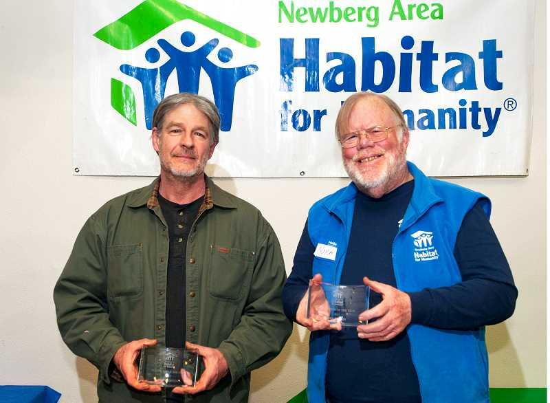 SUBMITTED PHOTO - Dennis Creigh and Norm Daviess were recognized as Newberg Habitat for Humanity's volunteers of the year during a ceremony held in February.