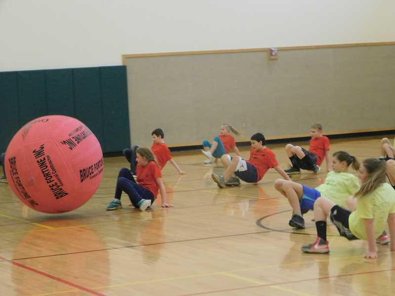 ESTACADA NEWS PHOTO: EMILY LINDSTRAND - Students participating in the River Mill Elementary School sports challenge face off against a large ball during one of the events.