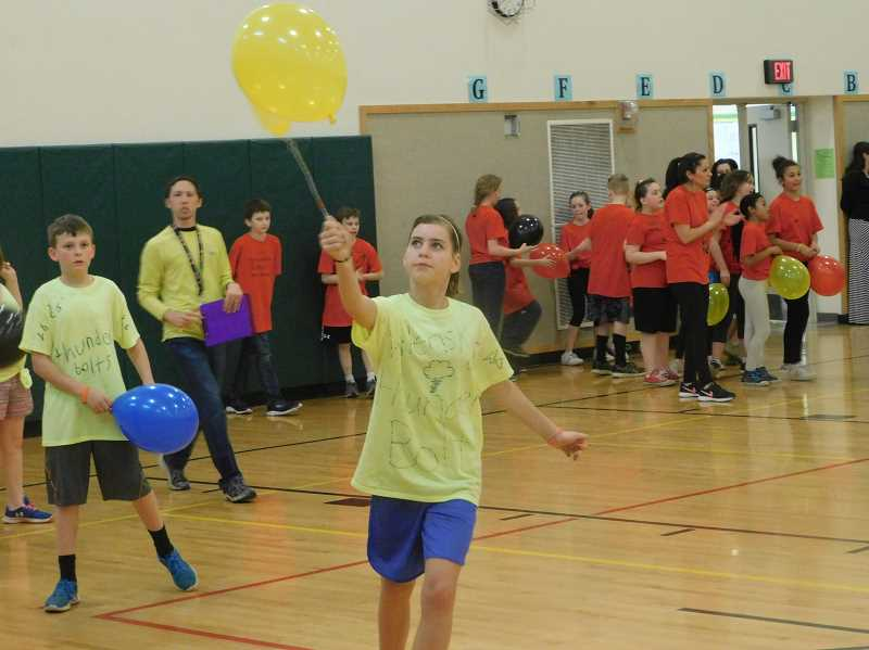 ESTACADA NEWS PHOTO: EMILY LINDSTRAND - Students participating in the River Mill Elementary sports had to carry balloons using fly swatters.
