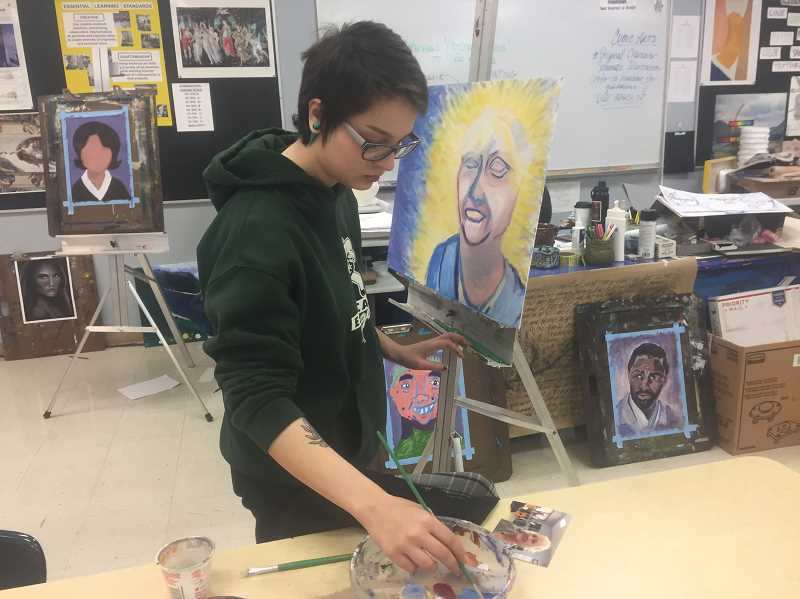 ESTACADA NEWS PHOTO: EMILY LINDSTRAND - Alexis Patterson works on a portrait of Jane Reid.