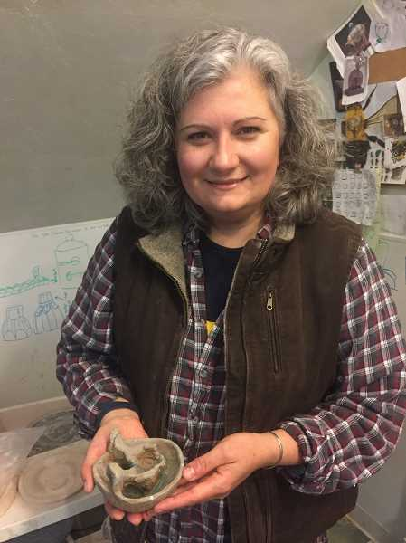 ESTACADA NEWS PHOTO: EMILY LINDSTRAND - Brenda Scott holds a miniature version of a decorative bowl she created. The full size version will be included in a show in Japan.