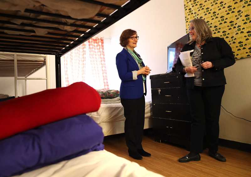 TIMES PHOTO: JAIME VALDEZ - U.S. Rep. Suzanne Bonamici, left, is shown around a room at Tigards Good Neighbor Center Tuesday by Renee Brouse, the centers executive director.