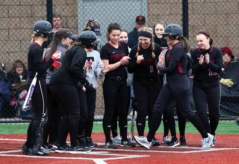 DAN BROOD - The Timberwolves greet senior Zoe Olivera (second from right) following her two-run home run in the third inning of the team's win over South Eugene.