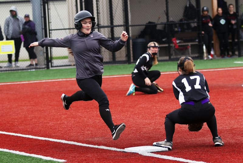 DAN BROOD - Tualatin senior Taylor Alton (left) stretches out to try to reach base during the game with South Eugene.