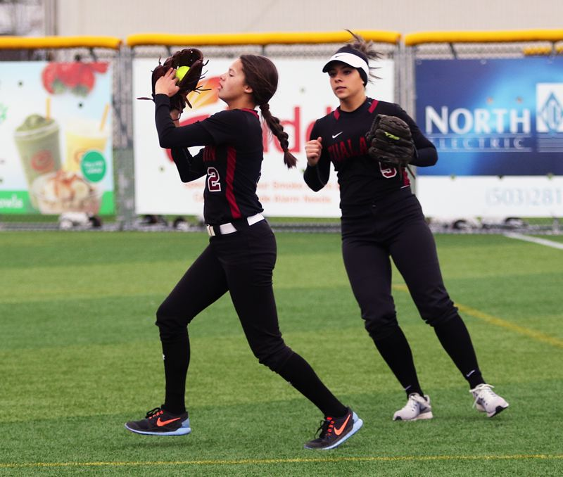 DAN BROOD - Tualatin sophomore Tia Ridings (left) makes a catch in right field during the win over South Eugene.