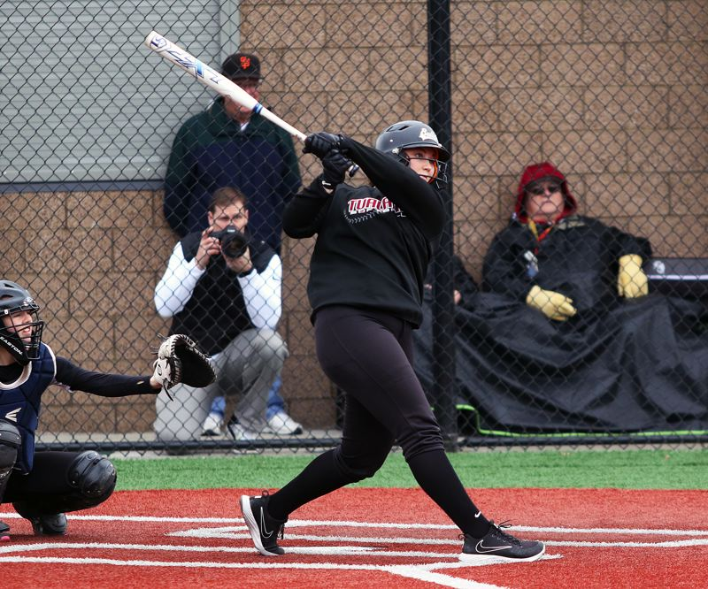 DAN BROOD - Tualatin junior Emily Johansen takes a big cut, resulting in a double off the top of the fence during the Wolves' win over South Eugene.