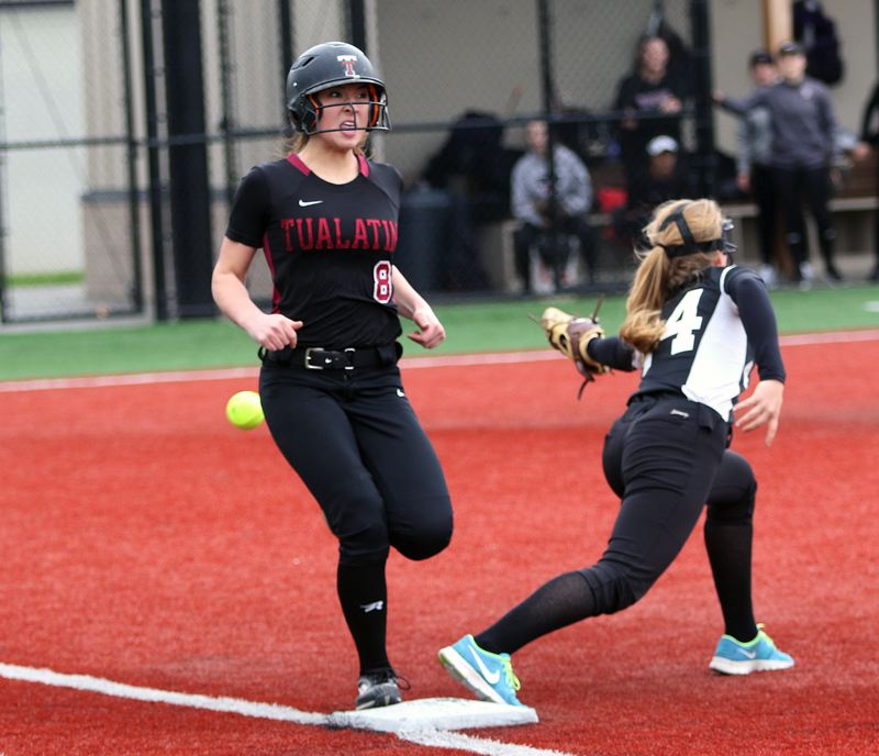 DAN BROOD - Tualatin junior Lily Marshall (left) is safe to first base on an infield single during Tuesday's game with South Eugene.