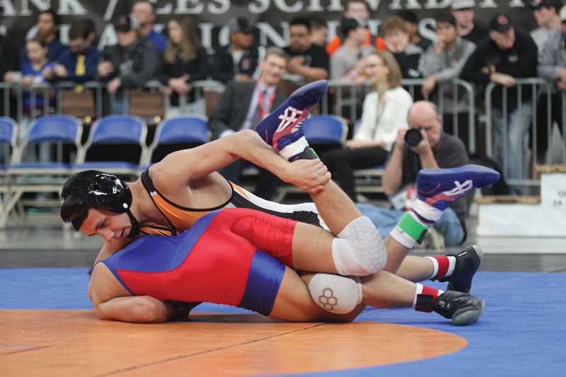 WILL DENNER/MADRAS PIONEER - Lorenzo Vasquez won his third state title in 2018, beating Myrtle Point's Tyler Huerta in the 120-pound division to finish the year 40-2.