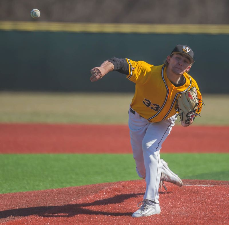 PHOTO COURTESY: MISSOURI WESTERN ATHLETICS - Nate Hunter follows through on a pitch during an early-season game for Division II Missouri Western.