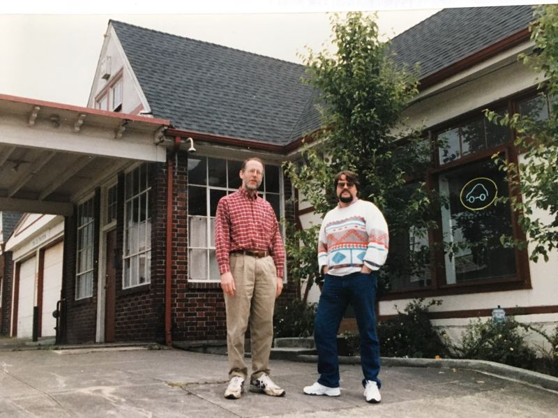 COURTESY: DAVE BROOK  - Dave Brook, founder of CarSharing Portland, along with his general manager, Russell Martin, standing in front of the original location and offices at Southeast 21st Avenue and Division Street. It later became the Mirador store.