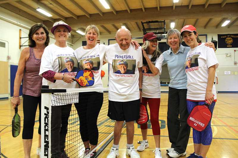 REVIEW PHOTO: SAM STITES - Lake Oswego resident George Kent (center) poses for a photo with the ladies of the LO Pickleball Club at his 97th birthday celebration.