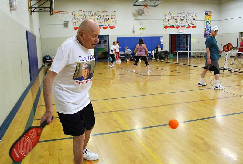 REVIEW PHOTO: SAM STITES - Pickleball is one of the fastest growing sports in the U.S. Here, George Kent swings at the ball in an attempt to get his opponents off center, a move designed to help his partner score on the next volley.