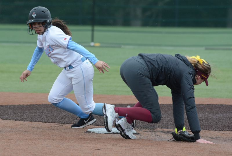 OUTLOOK PHOTO: DAVID BALL - Centennials Ashley Hawkins zips around second base after Forest Grove misses a throw on the infield.