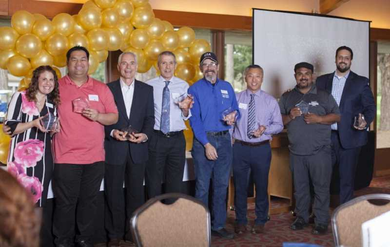 COURTESY TUALATIN CHAMBER OF COMMERCE - Lou Ogden, third from left, and others were honored Thursday at the Celebrate Tualatin Business Excellence Awards 2017