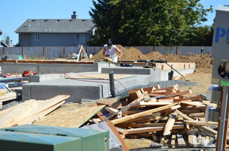 SPOTLIGHT FILE PHOTO - A construction worker build homes in the Dutch Canyon subdivision of Scappoose. More single-family and multi-family housing is also likely to add to the citys housing inventory soon.