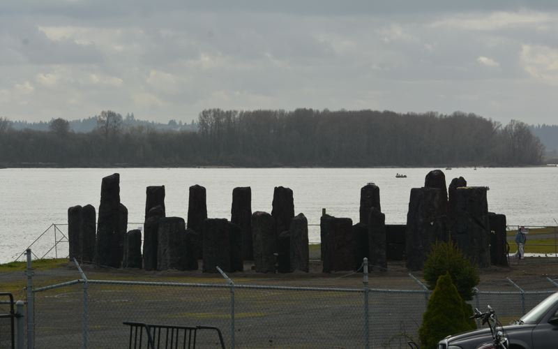 SPOTLIGHT PHOTO: COURTNEY VAUGHN - Styrofoam props made to mimic Stonehenge are stored in a fenced off area at the riverfront in downtown St. Helens. Some business owners and residents say the display is an eyesore and should be removed.