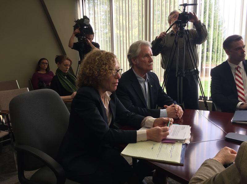 PARIS ACHEN/CAPITAL BUREAU - Left to right at table, attorney Janet Hoffman and former Gov. John Kitzhaber wait for a decision by the Oregon Government Ethics Commission on a proposed $20,000 settlement of ethics complaints against the former governor, during a meeting in Salem March 30, 2018.