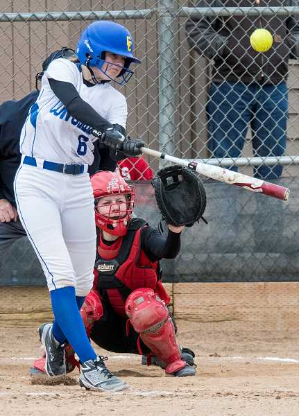 LON AUSTIN/CENTRAL OREGONIAN - Emma Lees rips a home run during the Cowgirls' 15-10 win over the Corbett Cardinals during the Redmond Spring Break Invitational.