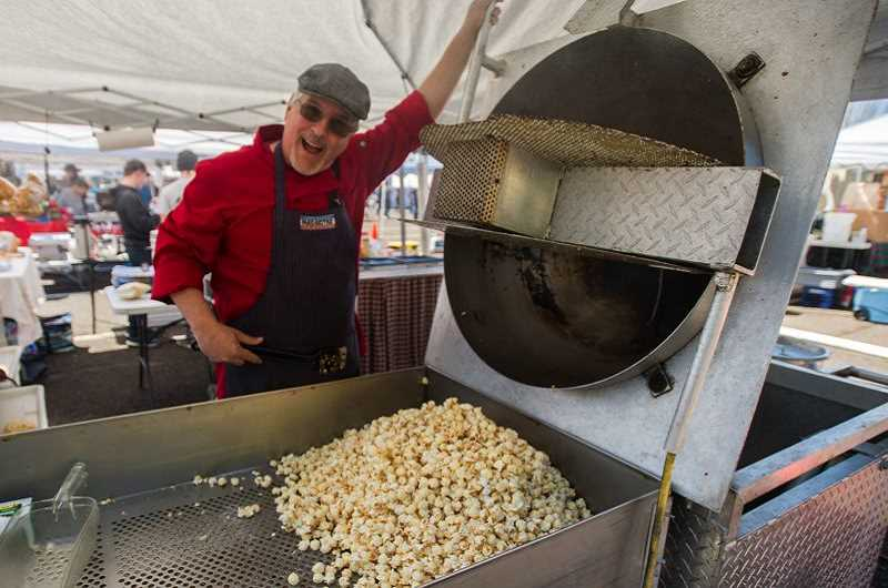 OUTLOOK FILE PHOTO - Mike Marselle of Munchies Kettle Corn shows off his ware at the Gresham Saturday Market on the Mt. Hood Community College campus.