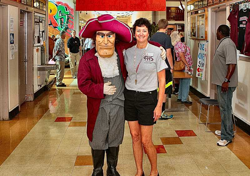 DAVID F. ASHTON - During the schools recent centennial celebration, the Franklin High School Quakers mascot gave a friendly hug to the then Franklin Alumni Association President Pam Knuth, a member of the Class of 75.