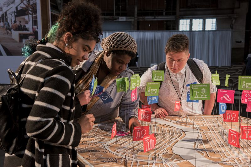 PAMPLIN MEDIA GROUP: FILE PHOTO - The large-scale metal interactive map of the Green Loop will be overlaid on cork. Participants dropping in at Design Week Portland Headquarters last year pinned ideas about the conditions that they would like to see in specific districts and neighborhood of the Green Loop.