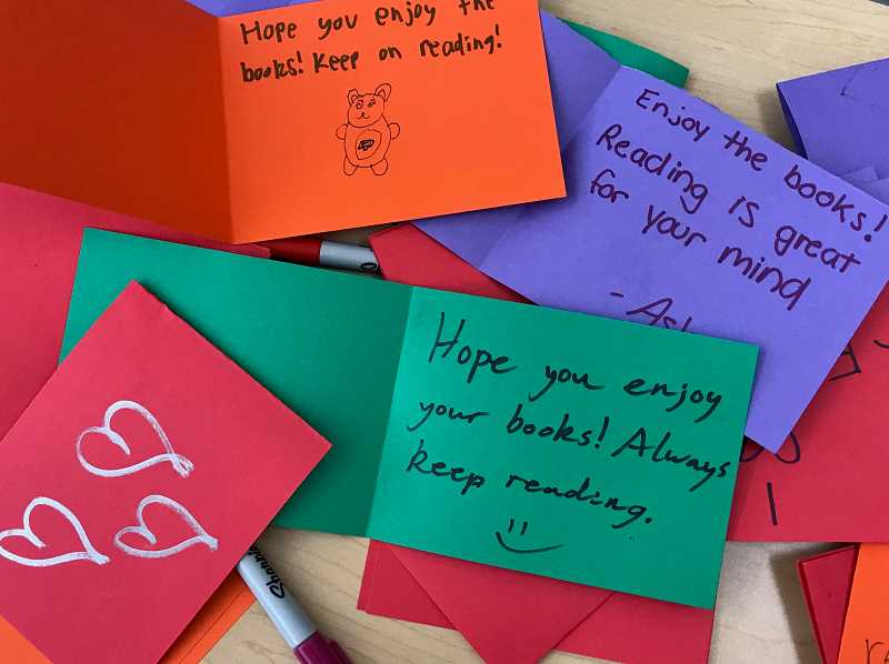 SUBMITTED PHOTO: KATHLEEN HANBERG - National Honor Society students created colorful cards for students who will be enjoying the books.