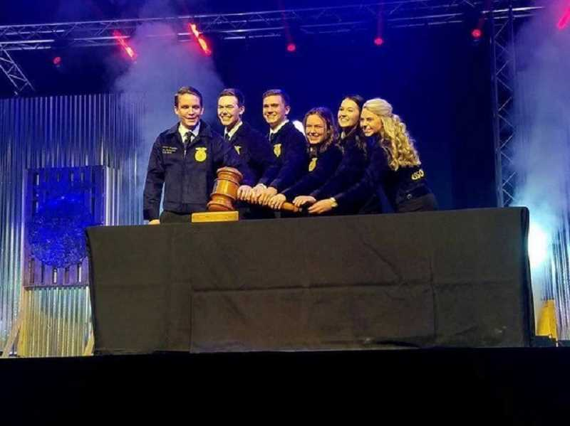 SUBMITTED PHOTO: PATTY ABELL - The newly elected Oregon State FFA Officers tap the gavel at the state convention on March 26. From left to right, they are Andrew Gmirkin of Eagle Point-president, Dylan Westfall of Hermiston-vice president, Devin Thacker of Canby-secretary, Mackenzie Price of Sutherlin-treasurer, Sundee Speelmon of Adrian-reporter and Holly Silver of Bend-sentinel.