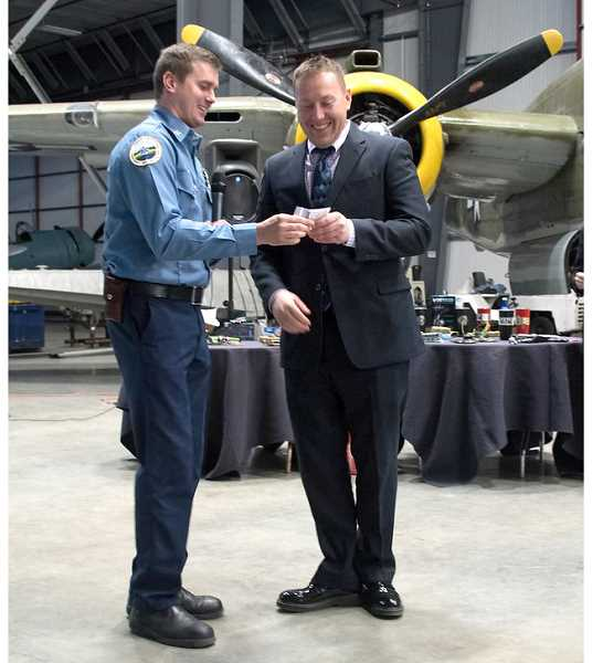 SUBMITTED PHOTO - Capt. Kasey Skaar awards Chief Brian Huff with his 20-year pin.