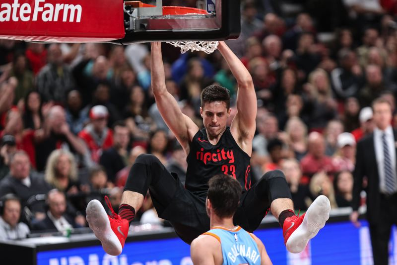 TRIBUNE PHOTO: DAVID BLAIR - Zach Collins dunks for the Trail Blazers during their win Friday night at home against the Los Angeles Clippers.