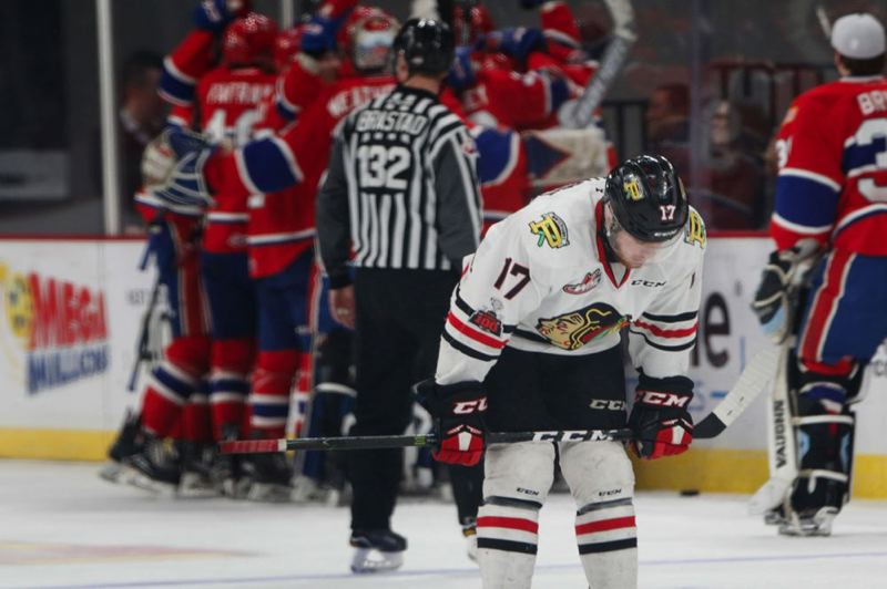 TRIBUNE PHOTO: JONATHAN HOUSE - Alex Overhardt of the Portland Winterhawks reacts after the Spokane Chiefs scored in overtime to win Saturday night at Memorial Coliseum.