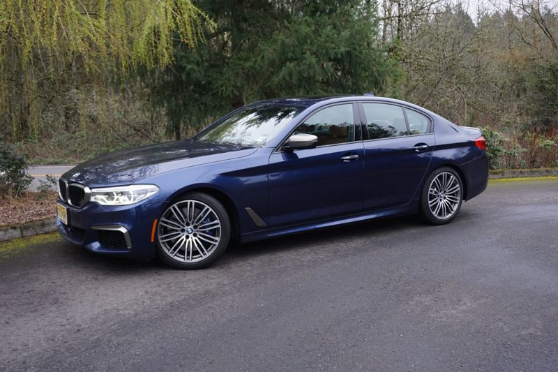 PORTLAND TRIBUNE: JEFF ZURSCHMEIDE - The 5-series is BMW's mid-size executive sedan, so the M550i is a fast car that can carry several friends to lunch or the golf course.