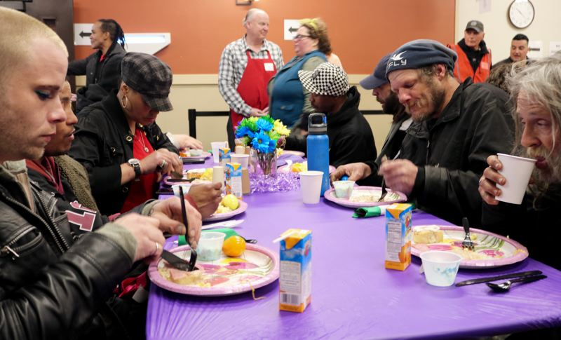 TRIBUNE PHOTO: ZANE SPARLING - Hungry folks chow down on Easter Sunday, April 1 at the Union Gospel Mission in downtown Portland.