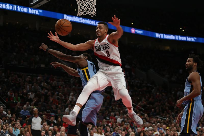 TRIBUNE PHOTO: JESSIE DARLAND - Trail Blazers guard CJ McCollum goes for the ball Sunday night against the Memphis Grizzlies.