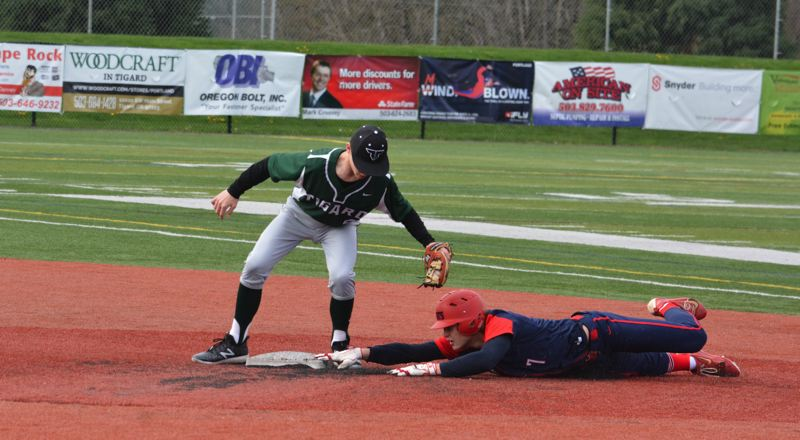 TIMES PHOTO: MATT SINGLEDECKER - Tigard second baseman Ethan Clark tries to tag out Westview senior shortstop Willie Weiss.