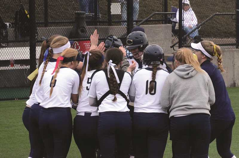 HERALD PHOTO: TANNER RUSS - The Cougars softball team celebrates senior Cassidy Posey after she hits her first high school homerun against Liberty High.