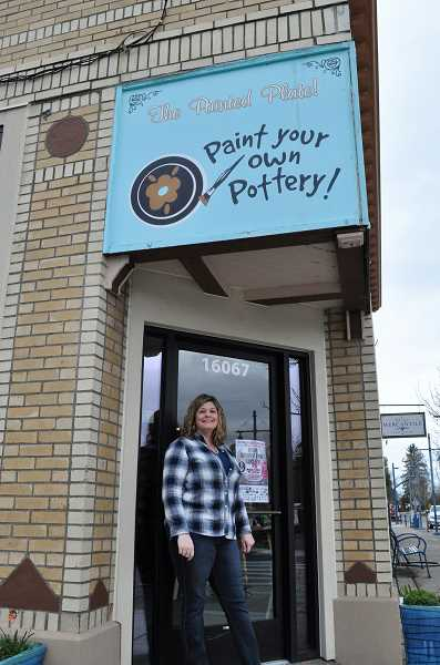 GAZETTE PHOTO: BLAIR STENVICK - Owner Tamara Bauer poses outside the Painted Plate in Sherwood's Old Town, which closed shop at the end of last month.