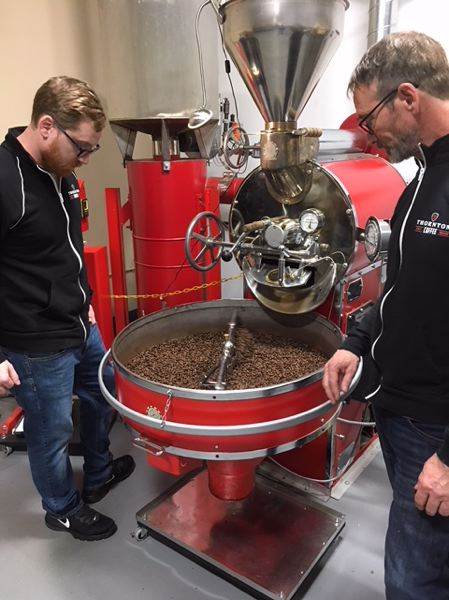 PAMPLIN MEDIA GROUP: PETER WONG - Paul Thornton, right, and Chris Verhaalen inspect the Ethiopian coffee beans they are preparing for Thornton Family Coffee Roasters, which just opened in Beaverton