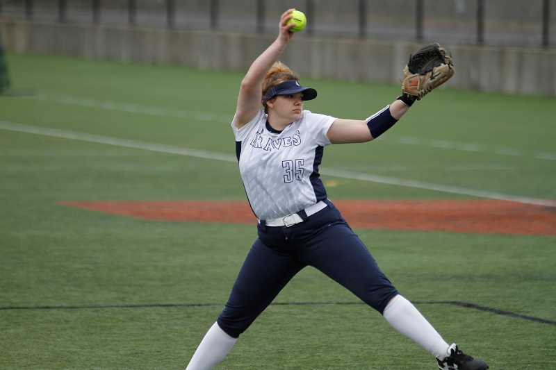 STAFF PHOTO: WADE EVANSON - Banks junior pitcher Michaela Shaw winds to throw a pitch during the Braves' game against Aloha during the Glencoe Softball Invitational Friday, March 30, at Hillsboro Stadium.