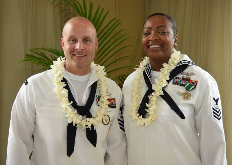 COURTESY PHOTO - Hillsboro resident Cole K. Tankersley, left, was named the Shore Sailor of the Year for the Pacific Fleet last month. A construction mechanic with the Navy, he and fellow sailor of the year Latoya Farrish, right, received awards in Hawaii last month for their outstanding service to the Navy.