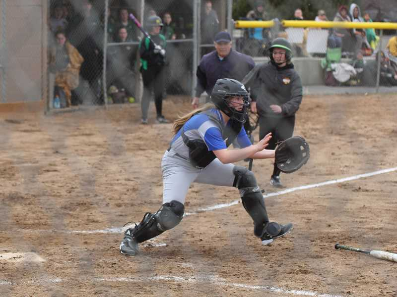 STEELE HAUGEN/MADRAS PIONEER - Hannah Holliday positions herself to make a play at the plate against Sweet Home. Madras lost to Sweet Home 10-0, but picked up its intensity to win three consecutive games.
