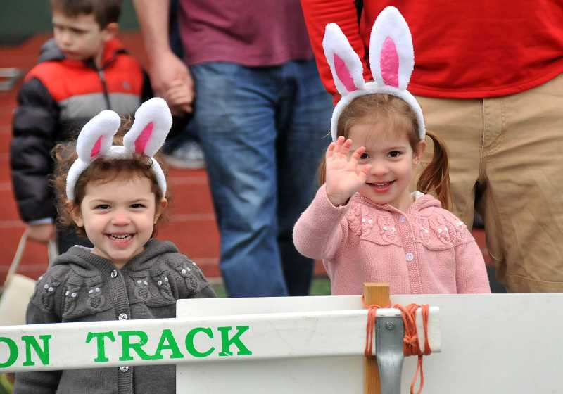 TIDINGS PHOTO: VERN UYETAKE - West Linns Julia, left, and Alexandra Bacon, both age 3, eagerly await the start  of the Lions sponsored egg hunt.