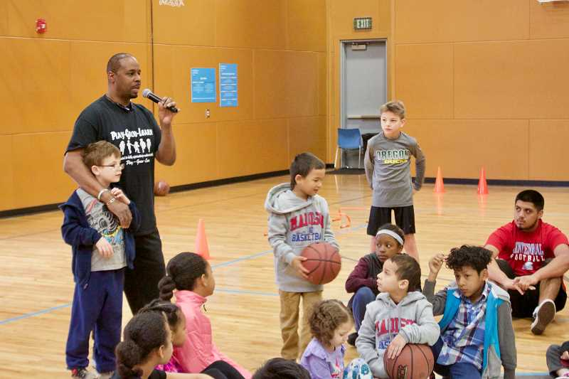 OUTLOOK PHOTO: CHRISTOPHER KEIZUR - Anthony Bradley, founder and executive director of Play-Grow-Learn, speaks with the kids during the Spring Break camp.