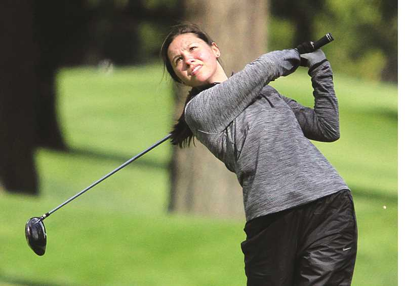 MILES VANCE -- TIGARD/TUALATIN TIMES - Newberg's Aly Davidson watches her shot fly on the fifth hole at Oswego Lake Country Club during the Three Rivers League tournament on Monday.