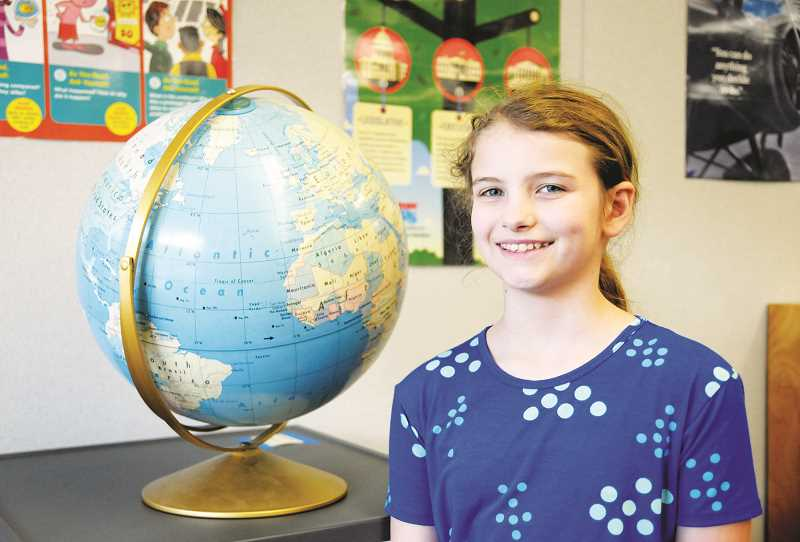 SETH GORDON - Dundee Elementary School fourth grade student Sophia Taylor is the first girl to earn the title of school champion in the geography bee contest.