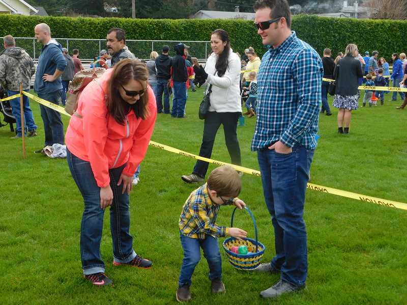 ESTACADA NEWS PHOTO: EMILY LINDSTRAND - Many families gathered to search for eggs at the Easter egg hunt on Saturday, March 31. The event was organized by the Estacada Fire Volunteer Association.