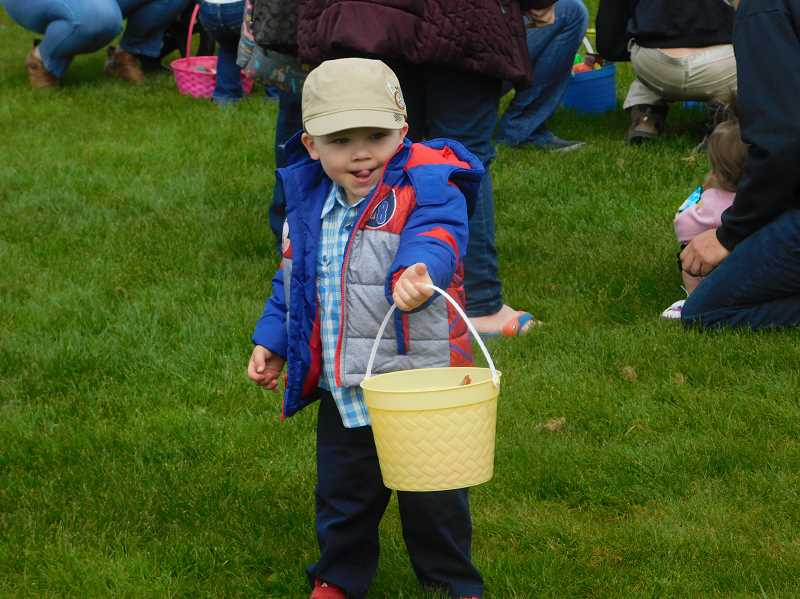 ESTACADA NEWS PHOTO: EMILY LINDSTRAND - An attendee of last weekend's Easter egg hunt surveys the field for goodies.